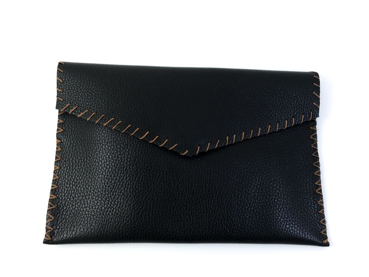 Clutch bag handmade from genuine calf leather . Unlined leather interior. Closes with magnetic clasp. Size: 28x18  Comes in a dust bag  Markella Fili Creations