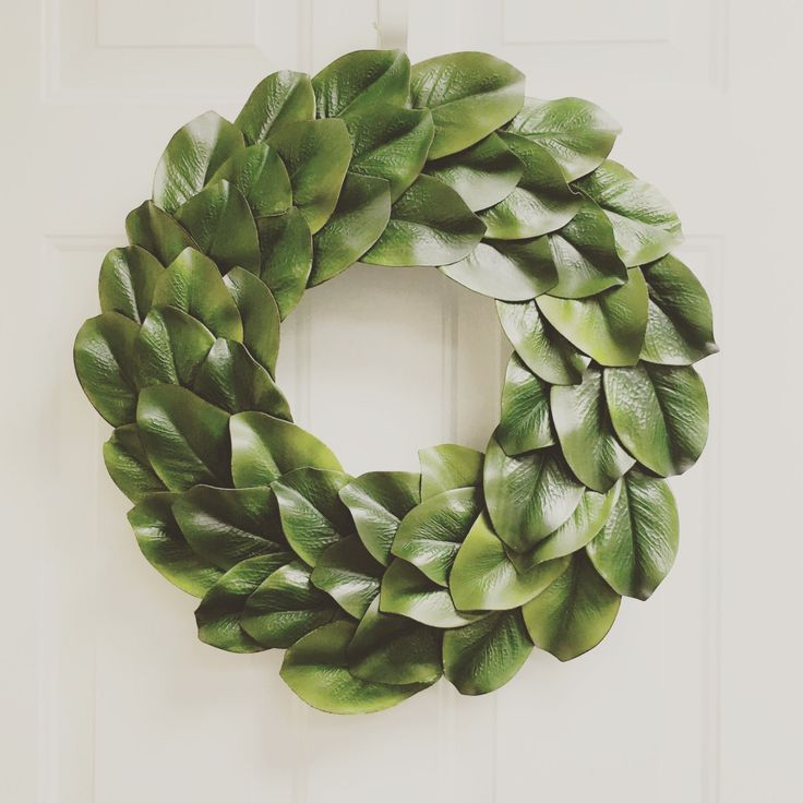 20 to 22 faux magnolia leaf wreath  This listing is for a beautiful, high quality, FAUX magnolia wreath, measuring 18 inches. The wreath has a hidden string of jute for hanging, however, I can add a ribbon of the color of your choice if youd like the wreath to hang from a bow.  Simply set on a shelf or hang up anywhere to add a touch of Joanna Gaines Fixer Upper style to your home decor, and at a fraction of the price!  There are so many options for decorating with this luxurious wreath in…