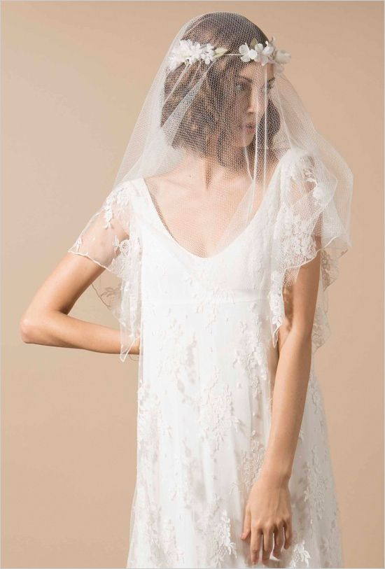 Swoop neck lace wedding gown by Delphine Manivet. --- http://www.weddingchicks.com/2014/06/05/delphine-manivet-wedding-dresses/