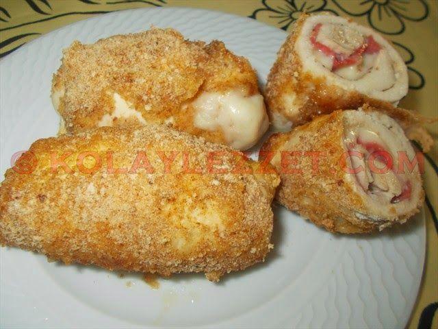 TAVUK-CORDON-BLEU Beş tane inceltilmiş tavuk biftek  Beş dilim kaşar peyniri  Beş dilim salam  Tuz ve karabiber  Mantolamak için: Un, yumurta ve galeta unu