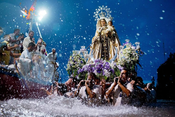 Jul. 15, 2014. Carriers of the Great God Power brotherhood unload the Virgen del Carmen statue at Puerto de la Cruz dock on the Canary islan...
