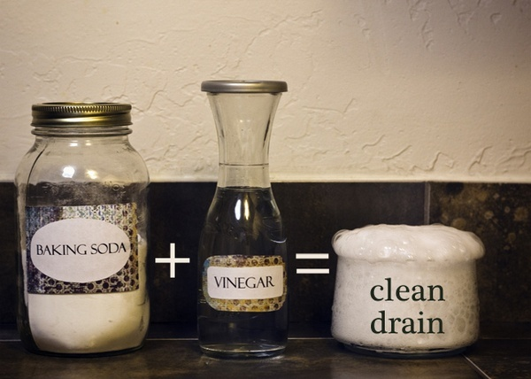 Pour 1/2 cup baking soda and then 1/2 cup of vinegar.  Cover up the drain during the crazy chemical reaction.  Wait 15 mins and pour a pot of boiling water.  It totally clears up the clogged drain caused by my hair and its easier on the pipes than Drano. Works every time!