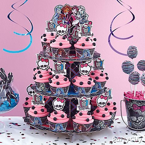 This Monster High cupcake tower will rule the birthday party scene! Decorate your cupcakes with pink icing color, black Sixlets® and Monster High treat picks!