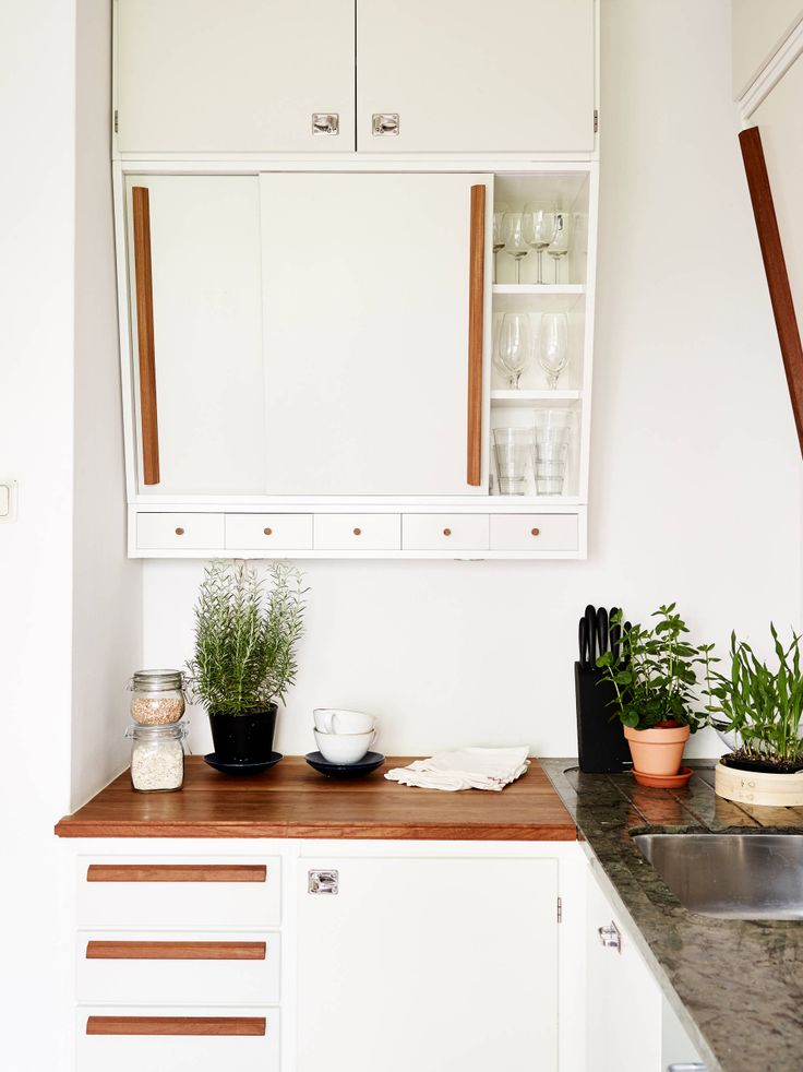 Bright, white retro mid century kitchen with wooden counters. I absolutely love it!