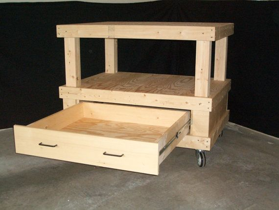 Small mobile cart with drawer.