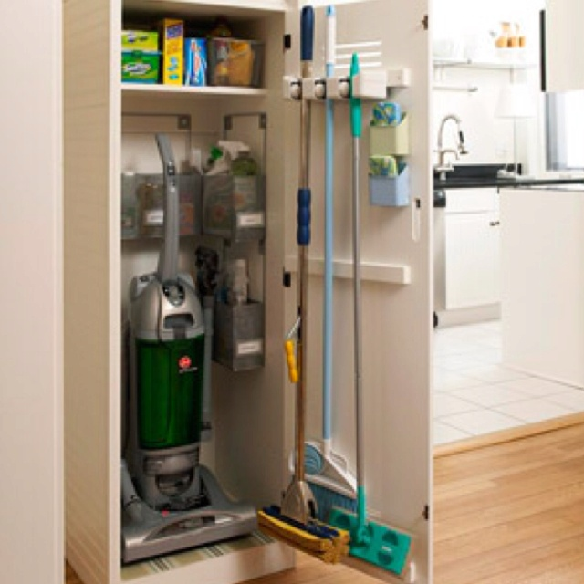Broom closet organization...there's never enough room so remember to use the BACK of the door too!