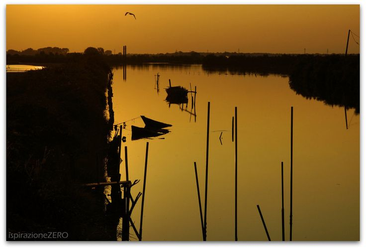 """Come un enorme specchio , la laguna di Marano attende in pace il tramonto del sole"" - The Marano Lagoon at sunset"