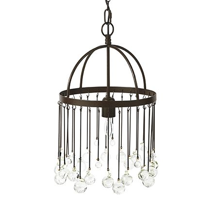 This chandelier features balls of recycled class hanging from an iron frame and surrounding a single bulb.