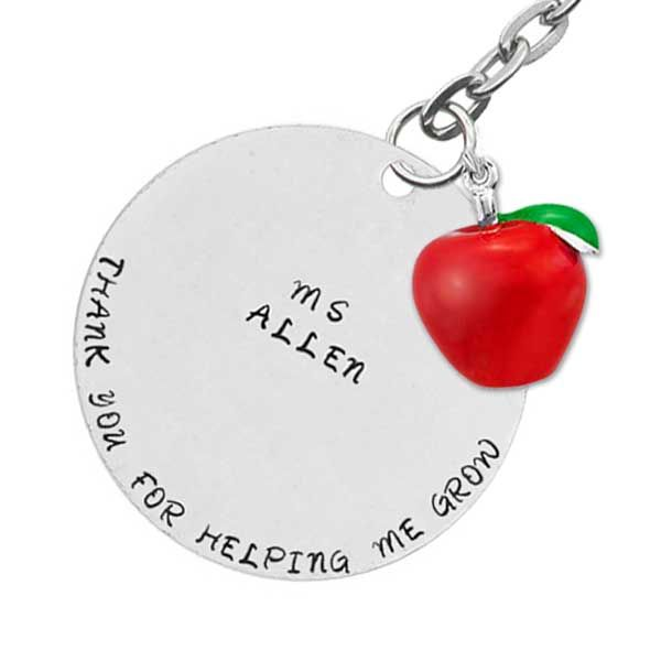 Teacher's Apple Personalised Keyring - A wonderful way to show your teacher how much you appreciate them.  Stylish personalised hand stamped keyring with a delightful red apple charm. Hand stamped on a 38mm (1.5inch) pewter tag with 3mm Bridgette uppercase lettering. Bridgette is a beautiful font that resembles handwriting – perfect for this design.
