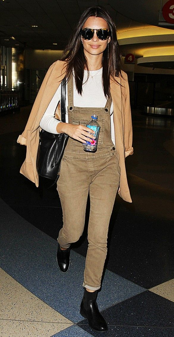 Emily Ratajkowski in a lightweight coat, overalls, and a long-sleeve tee