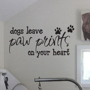 "love this! ""dogs leave paw prints on your heart"" decal"