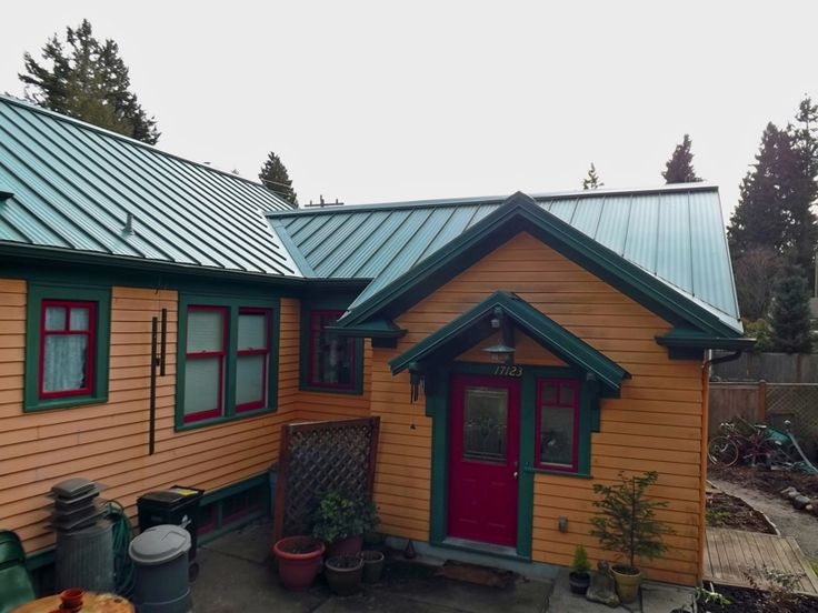 Green roof paint combo.. sorta of mimics the color of a cedar siding or log home. But painted