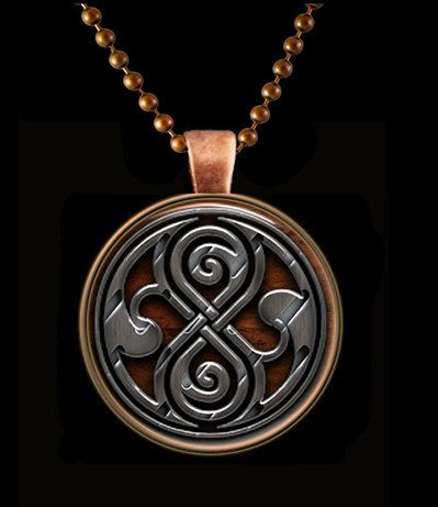 """The pendant is my rendition of Seal of Rassilon design and set in 1 inch Round Antiqued Copper Bezel with 24"""" Matching Copper Chain. The center is glass with my laser printed image sealed behind glass"""