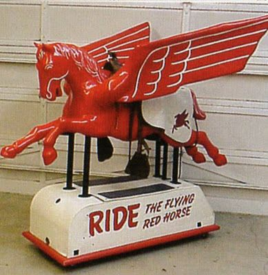 Mobil coin-operated Pegasus ride.: Pegasus, Remember This, Flying Red, Grocery Store, Coinop Riding, Coins Operation Riding, Red Out, Oil, Kid