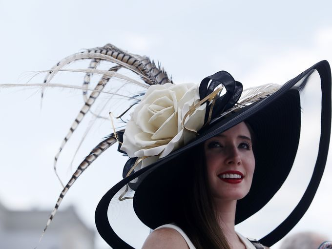 A patron wears a traditional hat before the 141st Kentucky