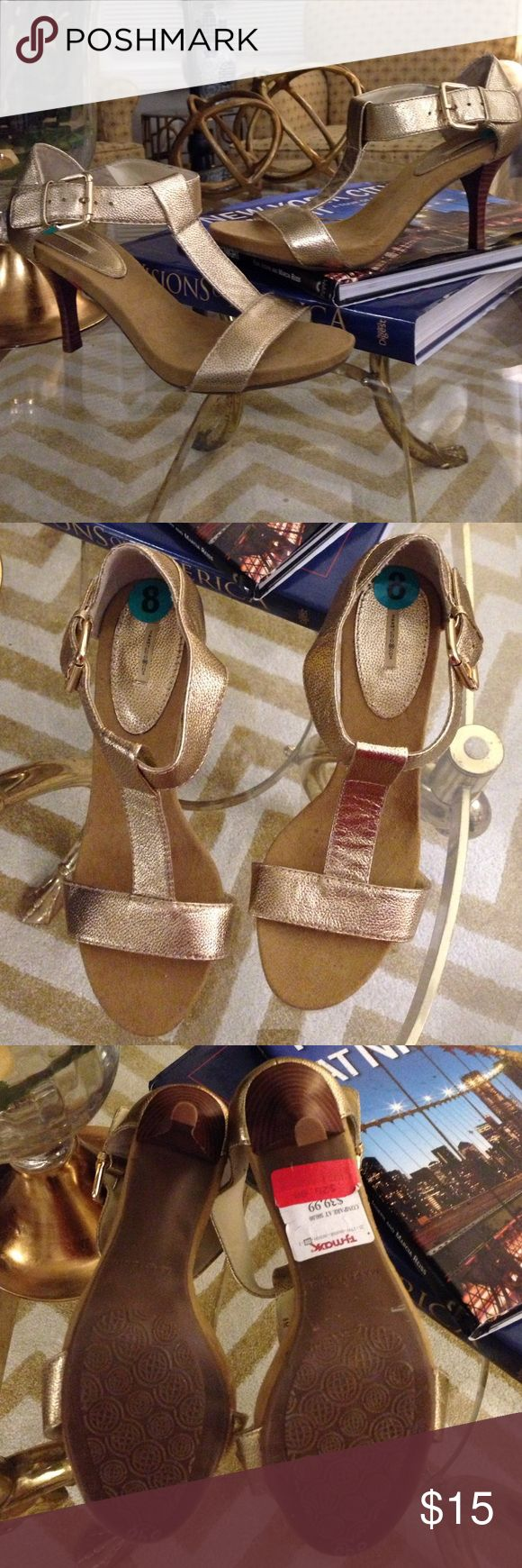 Brand New! Never been worn gold sandal heels Brand new with the tags on still! The heel is not high so they would be perfect to dress up or wear casually! Max Studio Shoes Sandals