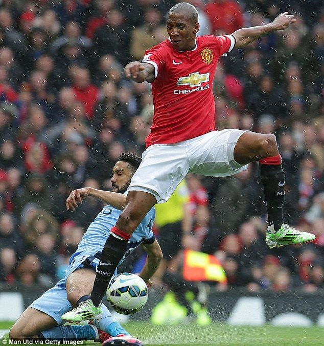 Former Arsenal defender Gael Clichy slides in for the ball against Manchester United's Ashley Young