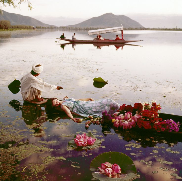 Norman Parkinson - Floating with flowers, India, Vogue. Barbara Mullen floating in a cotton mousseline dress by Atrima.