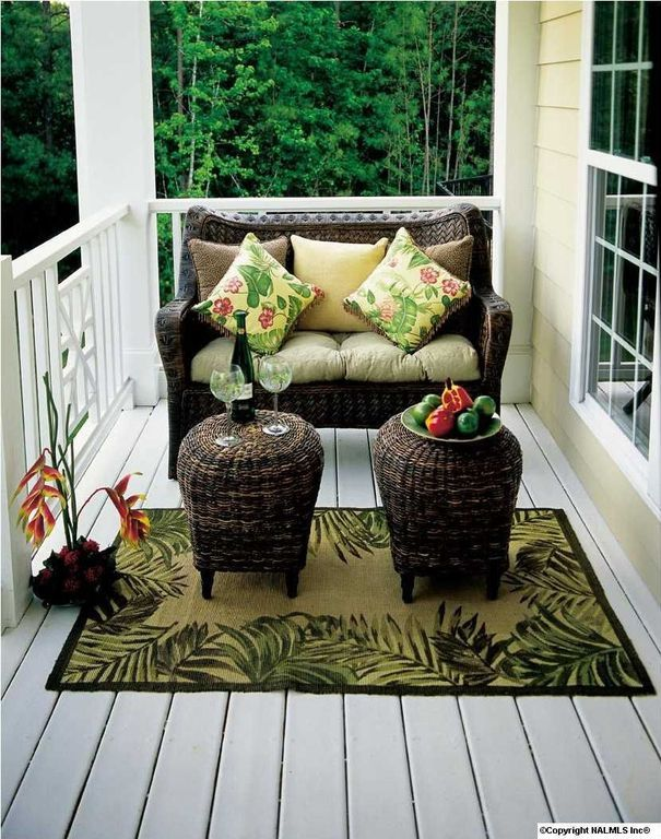 Tropical Porch with Porch swing, Wrap around porch, Sure Fit Wicker Patio Loveseat