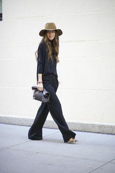 hang loose. black wide legged pants and wide brim hat