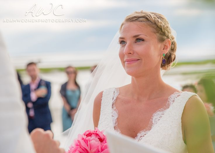 "Beautiful bride ""in the moment"" during her ceremony on the beach."