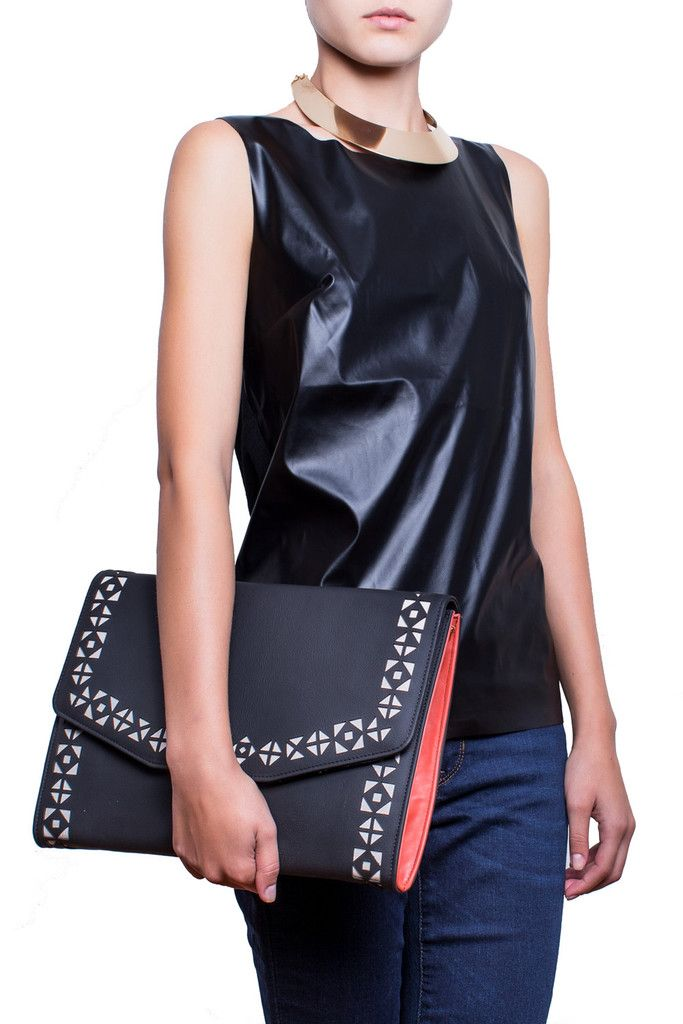 "Sophisticated and versatile, The Urban Story handcrafted leather clutch was inspired by the dinamic woman who loves an edgy look throughout any busy day or restless night, but needs to keep more than her essentials with her. Its perforated pattern is folklore inspired and gives a special flavour of ""je ne sais quoi"" to any outfit. #busta #bustabags #leatherclutch #leather #streetstyle #perforated #blue #embroidery #folklore #handmade #clutch #metalstrap #metalchain"