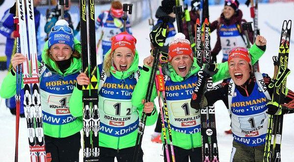 German team (L-R) Vanessa Hinz, Maren Hammerschmidt, Franziska Hildebrand and Laura Dahlmeier celebrate victory in the finish area of the 2017 IBU World Championships Biathlon Women's 4x6 km relay race in Hochfilzen on February 17, 2017. / AFP / FRANCK FIFE