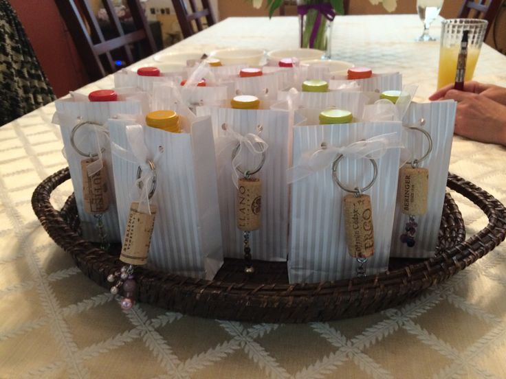 Gifts for wine themed wedding shower: small bottle of wine and homemade cork keychain.
