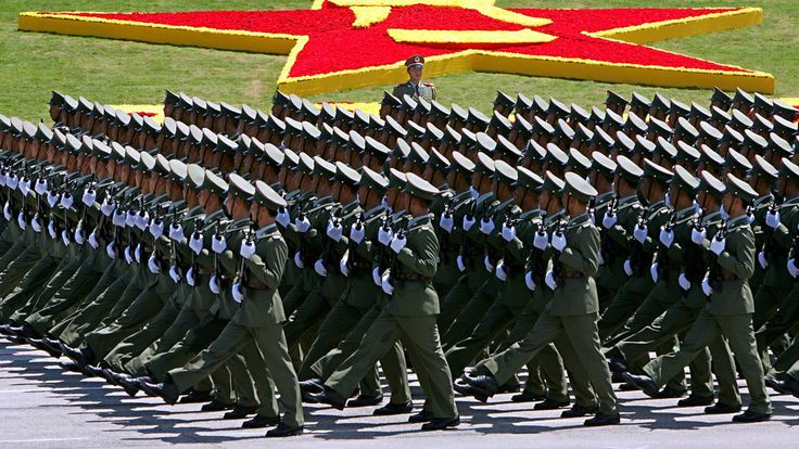 Enlisted servicemen of the Chinese People's Liberation Army Hong Kong Garrison marching through Shek Kong Airfield at the 2004 Chinese Armed Forces Day Parade.