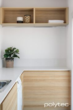 Contemporary style laundry with polytec doors in Natural Oak Ravine