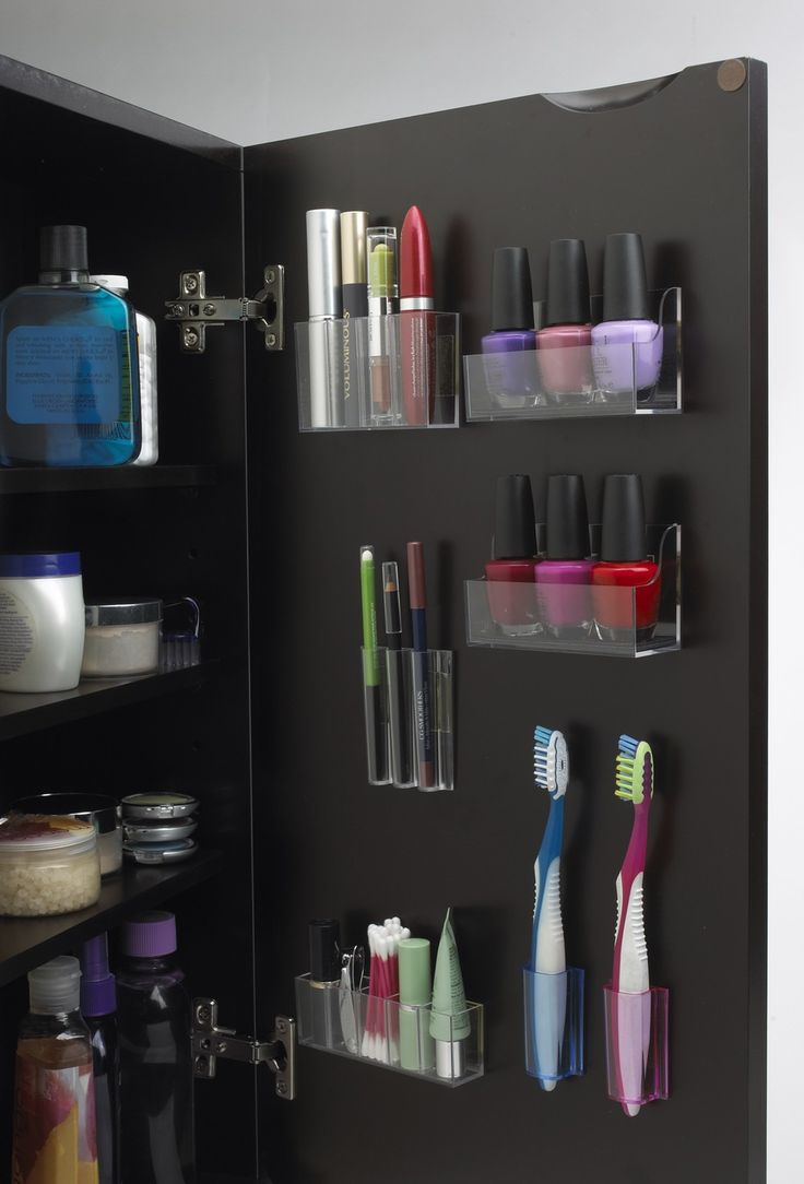 4 hacks to organize your teeny tiny bathroom: make use of medicine cabinet doors. Pick up some Stick On Pods to wrangle small items right on your medicine cabinet door. Talk about a smart use of dead space!