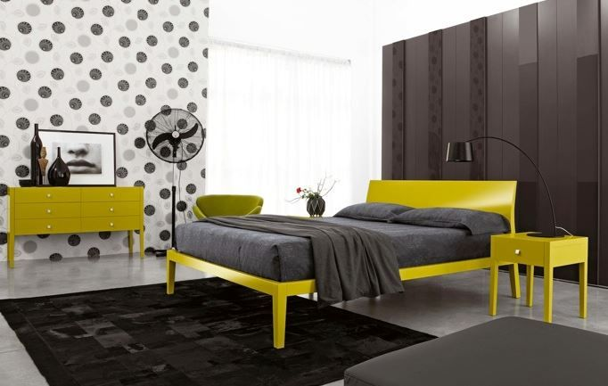 Cool wooden bed in 21 colours with matching furniture. A modern classic in the making.