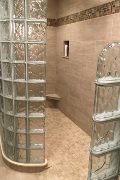 Glass block shower walls with a ready for tile shower pan and a step down wall. @InnovateBuild