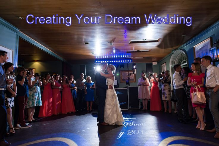 Stylish blue gobos and a wedding monogram projected onto the dancefloor for a romantic first dance - DJ Martin Lake