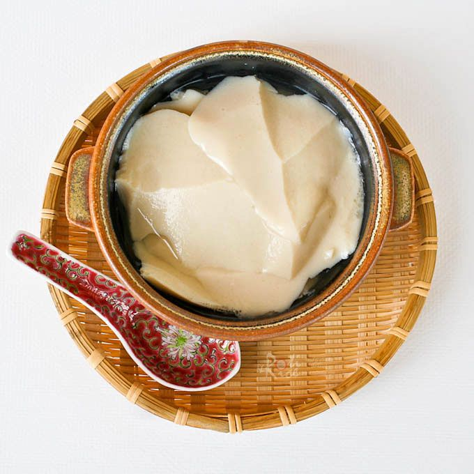 Tau Foo Fah - delicious silken tofu dessert eaten with a clear sweet syrup infused with ginger or pandan. Agar-agar powder is used as the coagulant.
