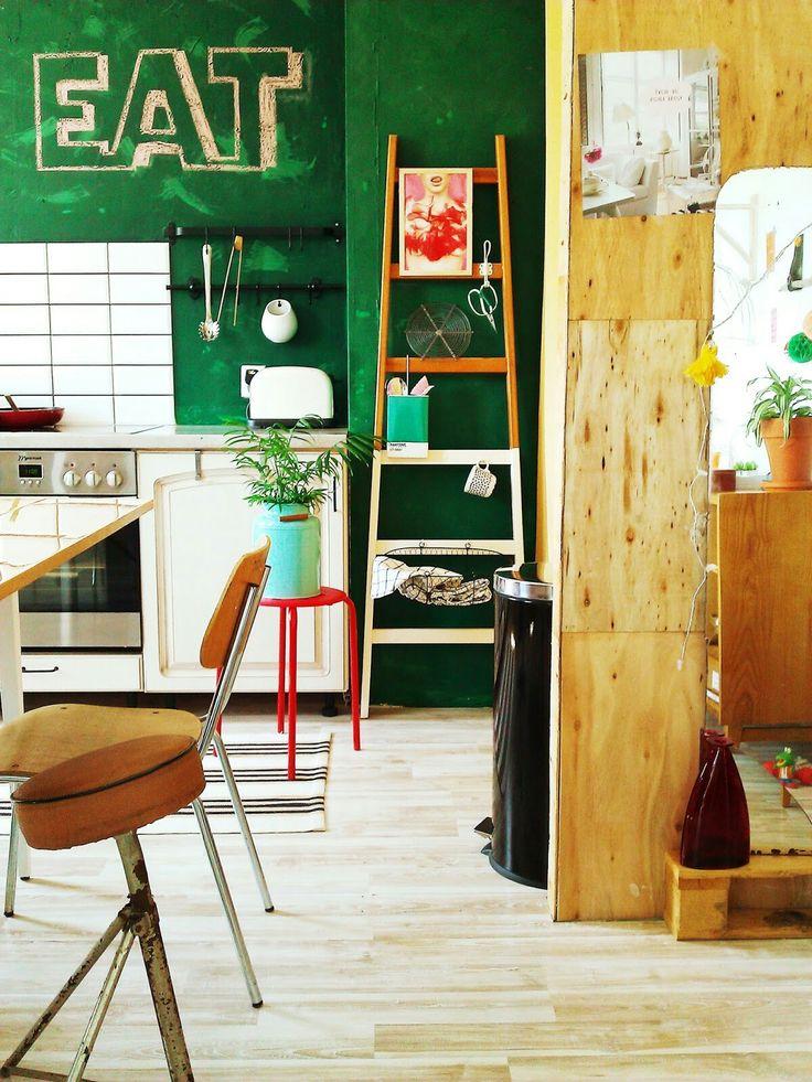 Ledder storage in my kitchen. Green chalkboard wall. School chair. Plywood wall.