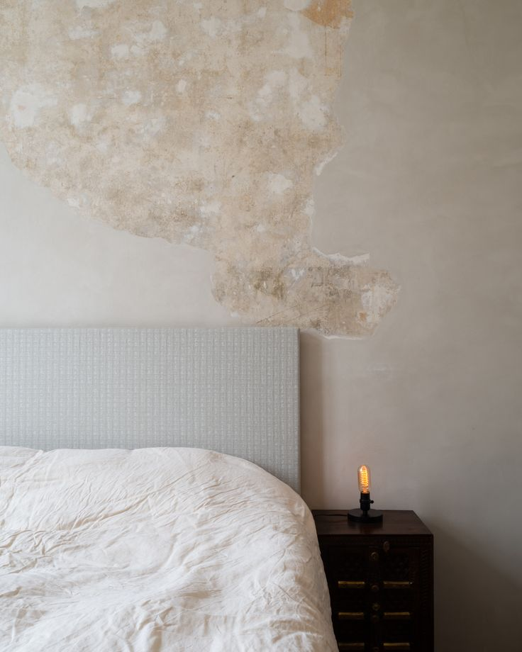Refurbishment of terraced home in Belsize Park, London. Bedroom.  Interior Design.  Preserved and Polished Plaster by Calfe Crimmings. Photographer - Jim Stephenson. Contractor - Mallett Construction.