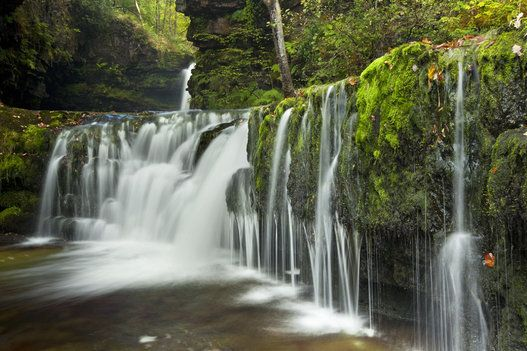 10 Hidden Waterfalls And Coves You Never Knew Were In The UK:  Perfect For… Rekindling Passion: Lower Ddwli Falls, Brecon Beacons Take you and the boy out of the rut and drive out into the Waterfall Woods (or Coed-y-Rhaiadr). You'll find falls galore, take your pick from Lady Falls, Einion Gam falls, Little Canyon, Horseshoe Falls, and our favourite, Lower Ddwli Falls, which comes with a deep forest plunge pool under wide-arched cascade. (antony spencer via Getty Images)
