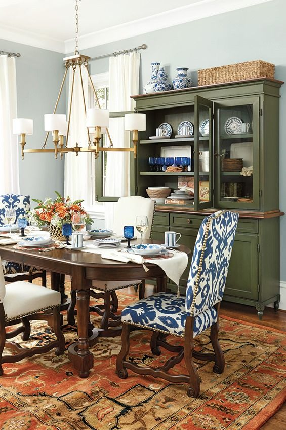 Deep Saturated Colors Bring Drama To This Dining Room Like A Red Rug Navy Chairs And Green Hutch