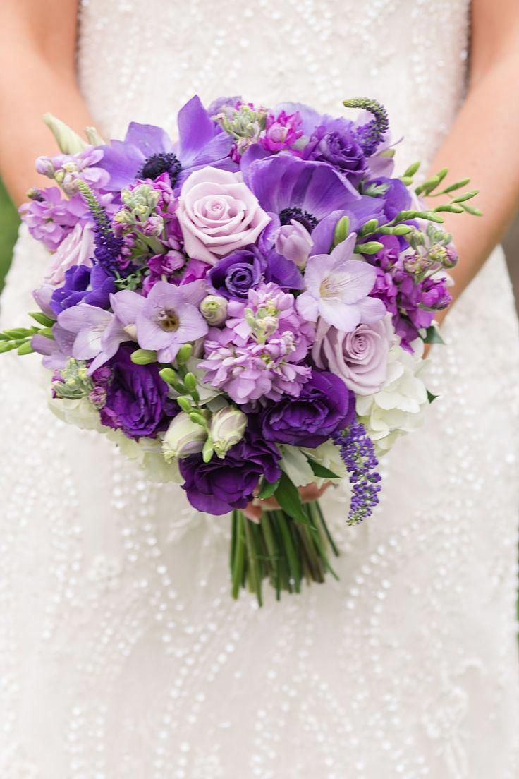 Purple Bridal Bouquet With Green Ribbon In The Hands Stock Photo