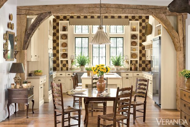 A tiled wall adds color and and pattern to this rustic kitchen. INTERIOR DESIGN BY DAN CARITHERS   - Veranda.com