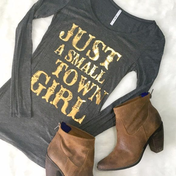 Just A Small Town Girl LS Tee We know we're not JUST small town girls - but why not enjoy your roots in this adorable top? Slim fit, lightweight material, great to toss in for a chilly morning or evening in the summer, perfect under a vest when the days are getting frosty! Note: top is charcoal, not black as shown on model. RESTOCKING: more sizes available soon!!! ChicBirdie Tops Tees - Long Sleeve