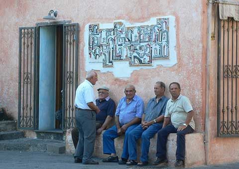 Old men chat in the square   Image Courtsey of heatheronhertravels