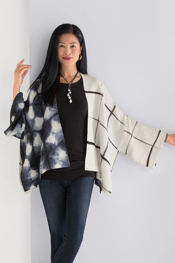 Luna Jacket by Laura Hunter . An exquisite work of art to wear, this jacket is hand dyed using traditional Japanese itajime shibori techniques. The artist carefully folds and binds the fabric before dyeing to create bold patterns that alternate with panels of solid black.