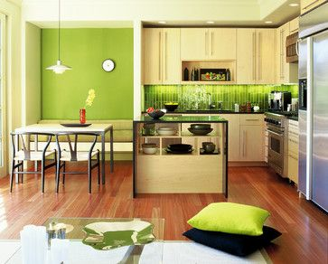 What I love about this space? The vibrant green is contained to the paint, backsplash and accessories so it would be a relatively easy way to change the look of the kitchen without a huge investment. I also like the nook space, but what I would do is make the island two-tiered and extend it the length of the nook as the tabletop.