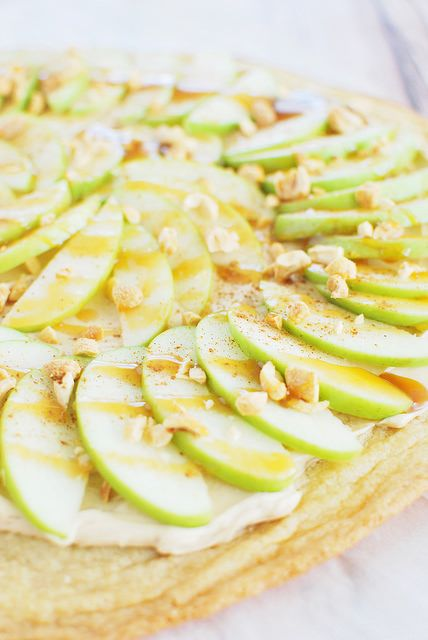Taffy Apple Pizza - a sugar crust with a sweetened cream cheese sauce, topping with apples and caramel!