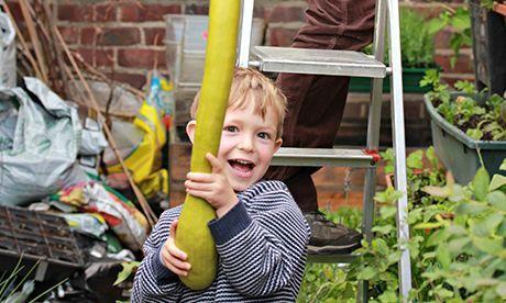 Mark's son with a home-grown tromba squash. Photograph: Mark Ridsdill Smith