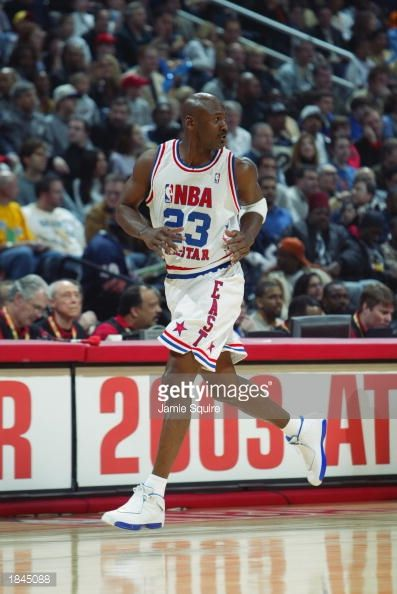Michael Jordan of the Eastern Conference AllStars runs upcourt during the 2003 NBA AllStar Game on February 9 2003 at Philips Arena in Atlanta...