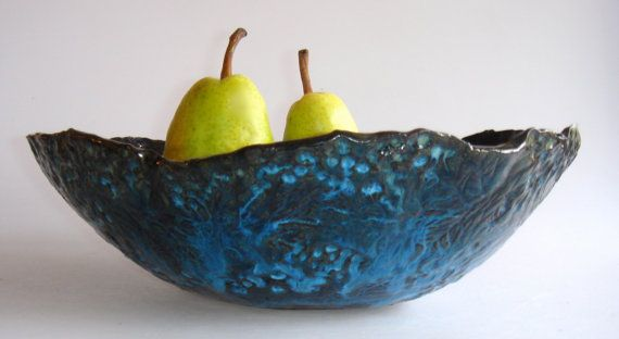 I've been trying all of my glazes on black clay -- have discovered that blues and red look great on it...greens just disappear!Servings Bowls