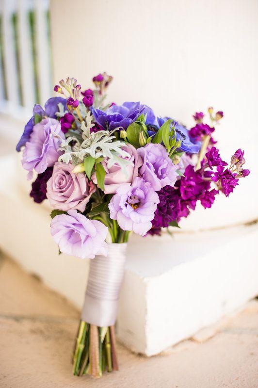 handtied bouquet of purple stock, lavender roses, purple lisianthus, purple anemones and dusty miller.